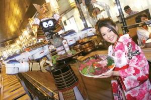 Mechanische obers in een restaurant in Bangkok serveren niet alleen uw gerechten, maar maken ook een mooi samba dansje.
